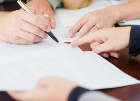signing papers for a home loan - kdd blog