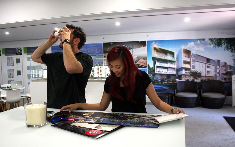 kdd conveyancing couple looking at house plans and vr